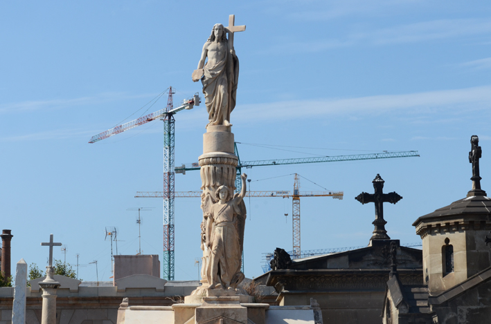 Pillared sculptures overlooking Poblenou Cemetery on a sunny day