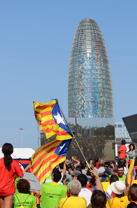 Torre Agbar overlooking Barcelona's 2014 La Diada demonstration
