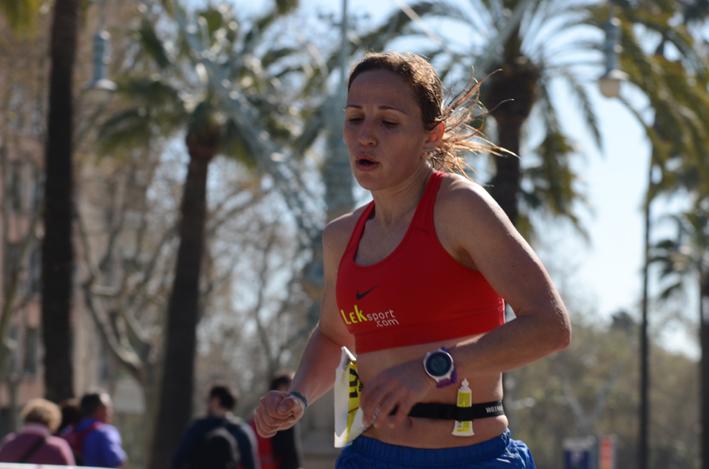 Woman running marathon race