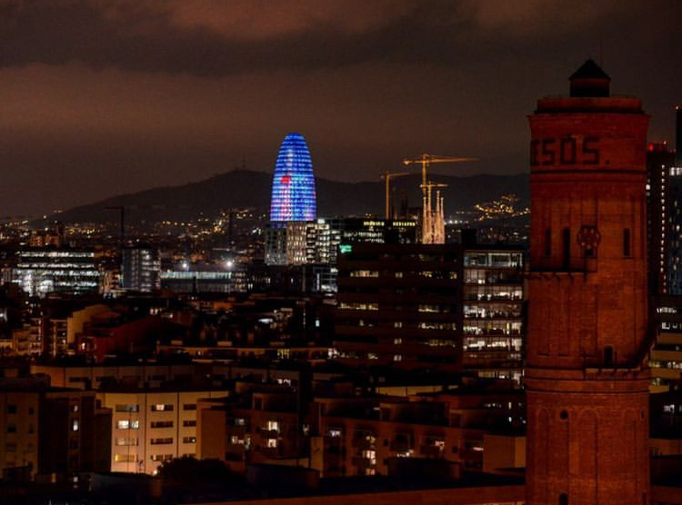 View of Torre Glòries at night with Sagrada Família in background