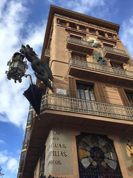 Casa Bruno Cuadros dragon seen from below against blue sky