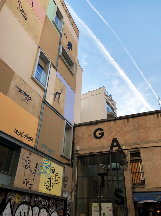 Lower view of the Gats mural and the Gats bar in El Raval in Barcelona