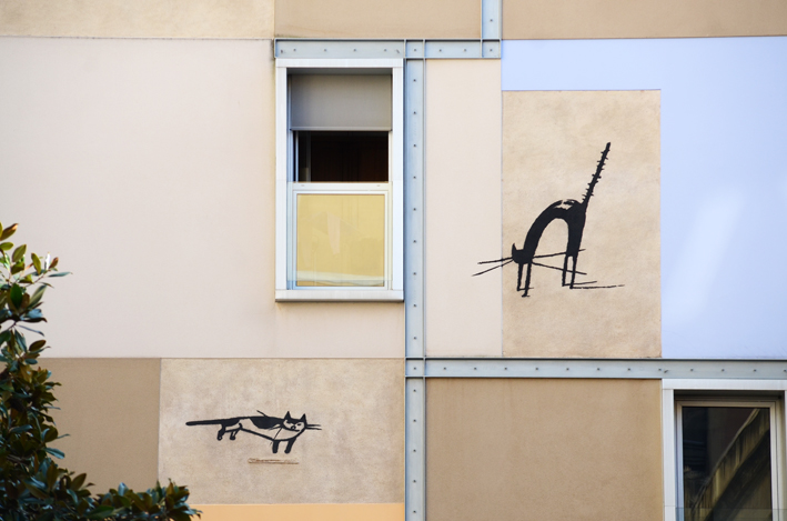 A close-up view of two cats of the Gats mural in El Raval in Barcelona