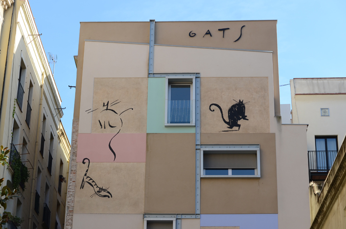 Close-up view of the upper part of the Gats mural in El Raval in Barcelona
