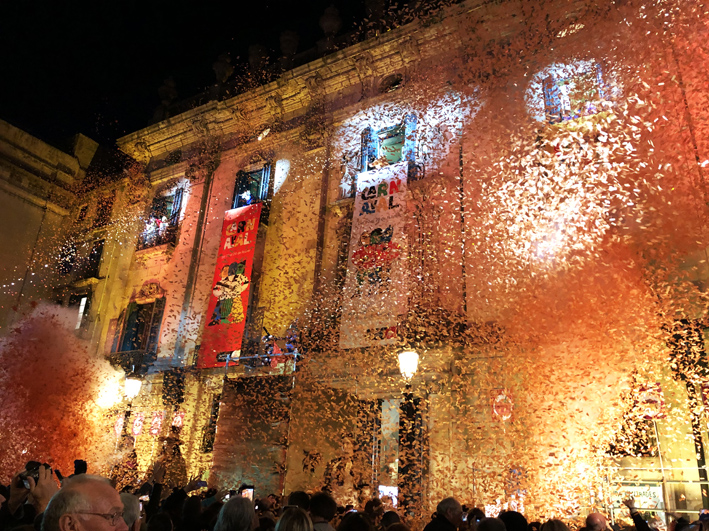 The 2020 Taronjada in front of Barcelona's La Virreina with a cloud of orange confetti